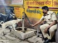 Watch: Varanasi Cop Helping Thirsty Dog Drink Water Wins Hearts On Internet