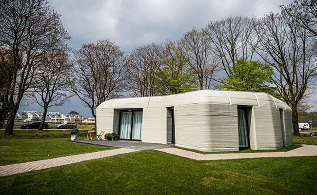 This 3D-Printed House, Shaped Like A Boulder, Just Got Its First Tenants