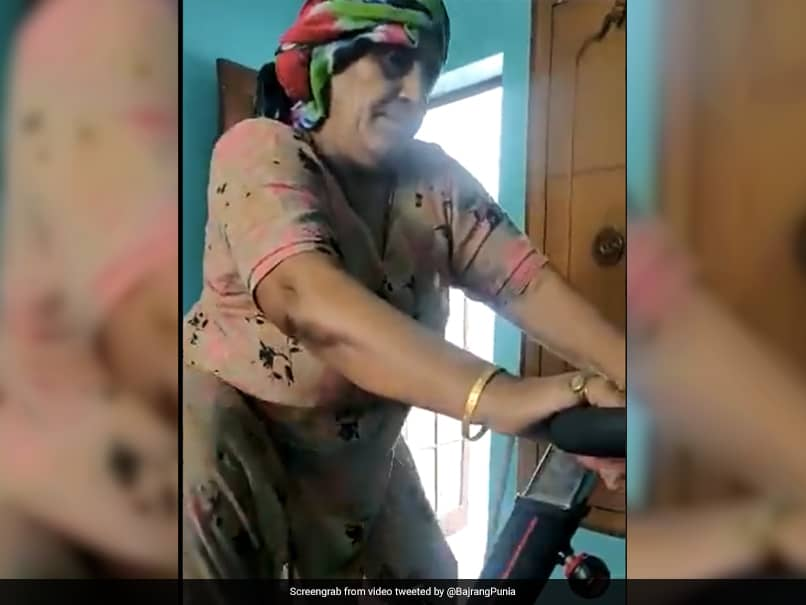 Watch: Wrestler Bajrang Punias Mother Beats Lockdown Blues By Working Out On Exercise Bike At Home