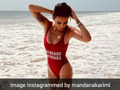 Thanks To Mandana Karimi In A Red Swimsuit, The Mercury Is Rising And How
