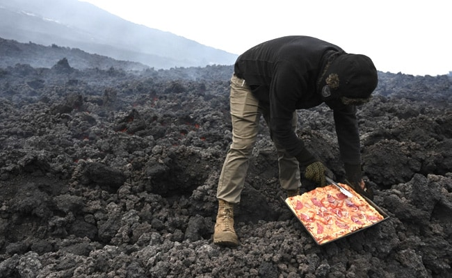 Man Cooks Pizza On Smouldering Volcano