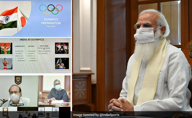 PM Stresses On Vaccination For All Travelling To Tokyo At Olympics Review Meet