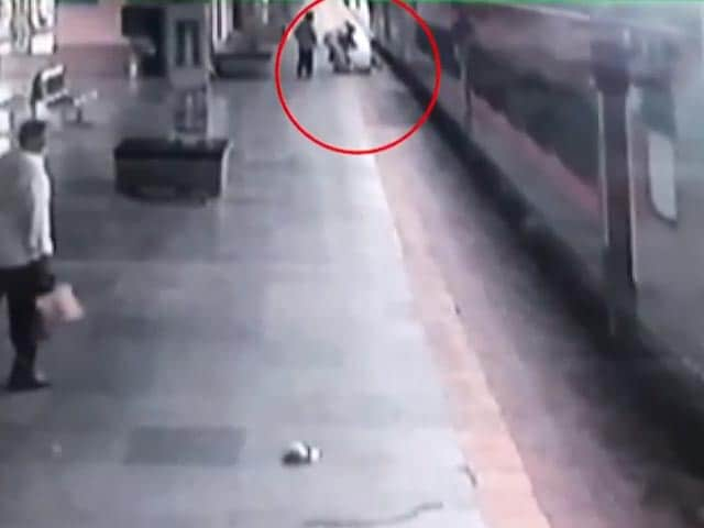 Video : Man Slips Trying To Board Moving Train, Cop Saves Him
