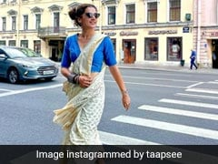 Taapsee Pannu Takes Over Saint Petersburg In Style Wearing A Printed <i>Saree</i> With Sneakers