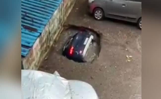 Car Swallowed By Sinkhole At Mumbai Parking Lot After Rain