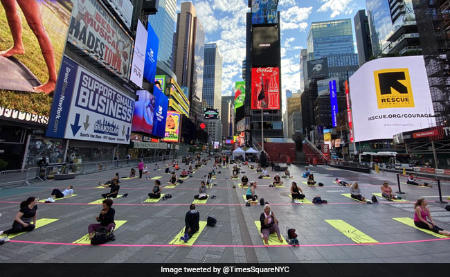 Over 3,000 People Perform Yoga At Iconic Times Square
