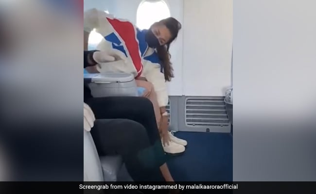 Malaika Arora Never Forgets To Stretch Even When On A Plane. No Excuses