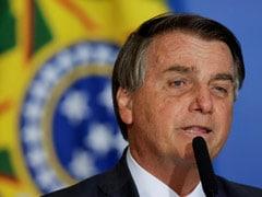 Brazil President Bolsonaro's Supporters Breach Police Blockade During Protest