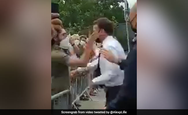On Camera, France's Macron Slapped By Man He Tried To Shake Hands With