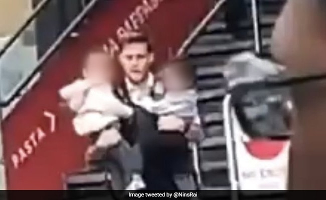 Watch: Hero Cop Rescues Two Children From Burning Station