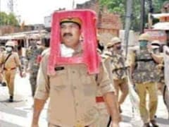 UP Cop Uses Plastic Stool As Riot Gear, Bosses Demand Explanation