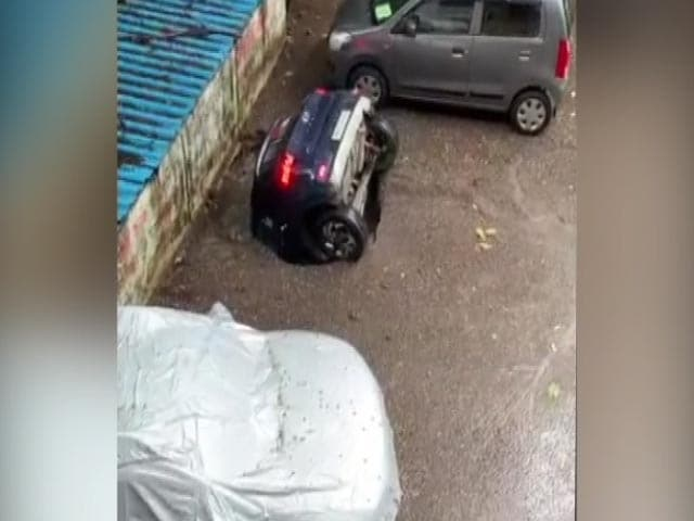 Video : Video: Car Swallowed By Sinkhole At Mumbai Parking Lot After Rain