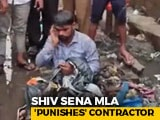 """Video : On Camera, Sena MLA Dumps Garbage On Man For """"Not Getting Drains Cleaned"""""""