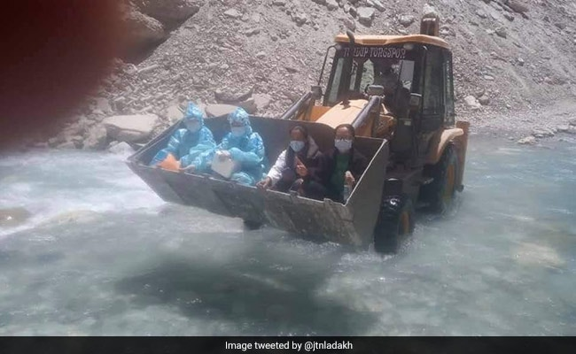 Internet Applauds COVID-19 Warriors Crossing A Ladakh River In An Earth Mover