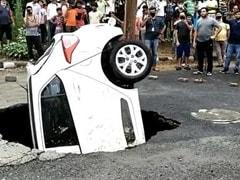 Video: Delhi Cop's Car Falls Into Sinkhole While Being Driven After Rain