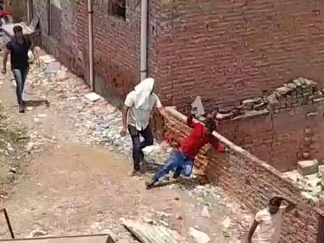 Video : Caught On Camera: Man Slapped, Knocked Out In Haryana Colony Being Razed