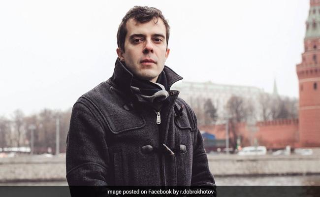 Russian Police Raid Home Of Investigative Journalist Over Slander Case