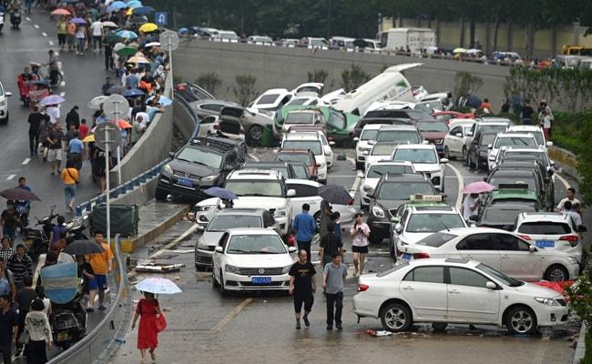 Chinese City Picks Through The Debris After Record Rain Kills 33