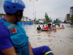 China Evacuates Thousands As Storms Spread North, Flood Deaths Rise To 33