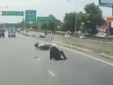 Video: Distracted Rider Barrels Straight Into Road Divider