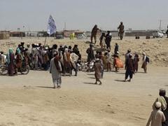 Afghan Fighting Rages As US, UK Accuse Taliban Of Massacring Civilians