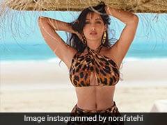 Nora Fatehi Celebrates 30 Million Followers In A Stunning Leopard Bikini And A Rs 2.2 Lakh Fendi Bag