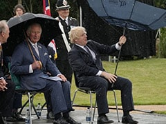 Twitter Can't Stop Watching Boris Johnson Struggle With Umbrella At Memorial Service