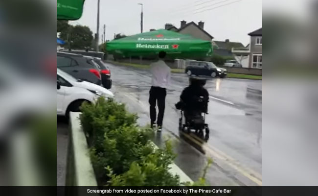 Watch: Cafe Worker Helps Wheelchair-Bound Patron Get Home In Pouring Rain