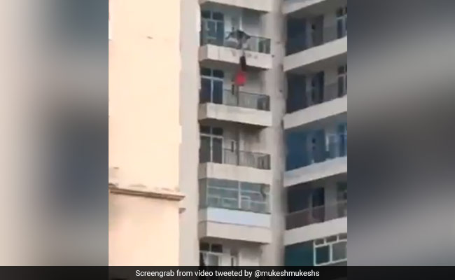 Video: Man Holds On To Woman Hanging From Balcony. She Falls, Survives