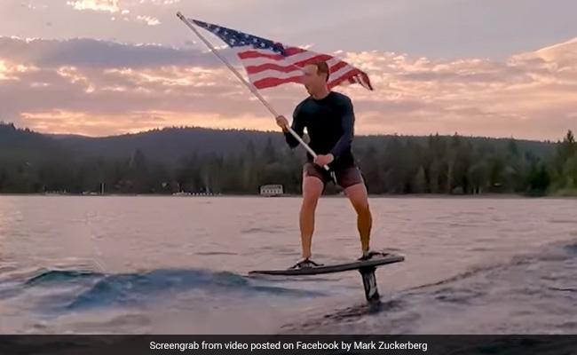 Mark Zuckerberg's Surfing Video Holding US Flag Has Internet Divided