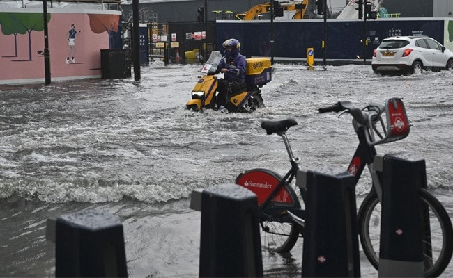 London 'Dealing With Numerous Floods In The East' As Storms Roll In