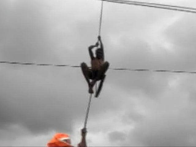 Video : Watch: 2 Men Stuck Over Swollen River In Maharashtra, Rescued By Disaster Force