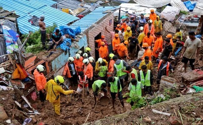 In Pics: Heavy Rains Cause Waterlogging In Mumbai, Train Services Hit