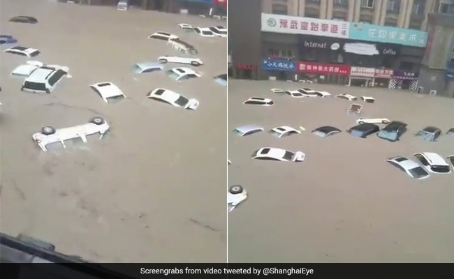 Zhengzhou Flood: Cars Float Down A Road After Devastating Floods In China