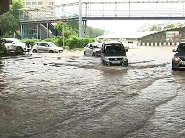Video : People Wade Through Submerged Roads After Heavy Rain In Gurgaon