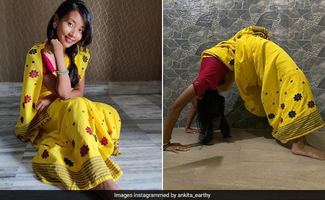 Only Milind Soman's Wife Ankita Konwar Can Strike A Yoga Pose In A Sunshine Yellow Mekhela Chador Saree