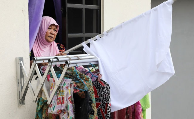 As COVID-19 Lockdown Bites, Malaysians Hoist White Flags In Plea For Help