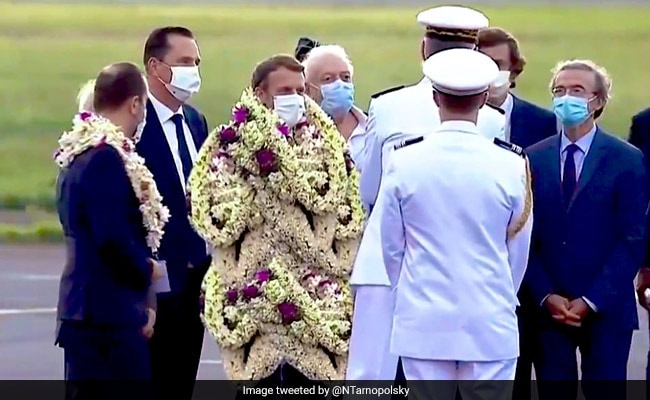 Truth Behind Viral Pic Of French President Emmanuel Macron Covered In Garlands