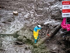 Rescuers Search For Survivors In Landslide-Hit Japan Town