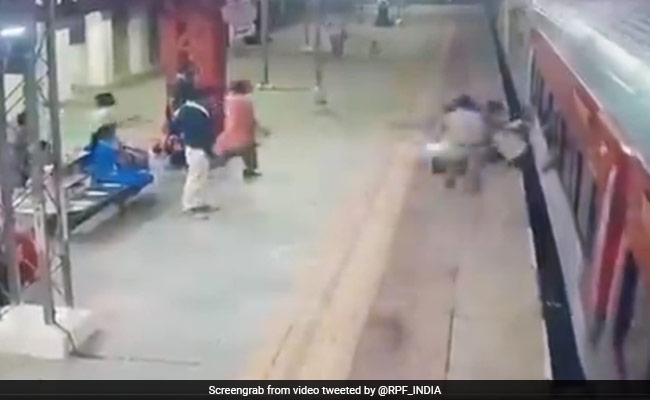 Watch: Man Falls Trying To Board Moving Train, Gets Dragged, Saved By Cop