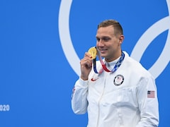 Tokyo Games: Swimmer Caeleb Dressel Wins 100m Freestyle Gold As Virus Casts Shadow At Olympics