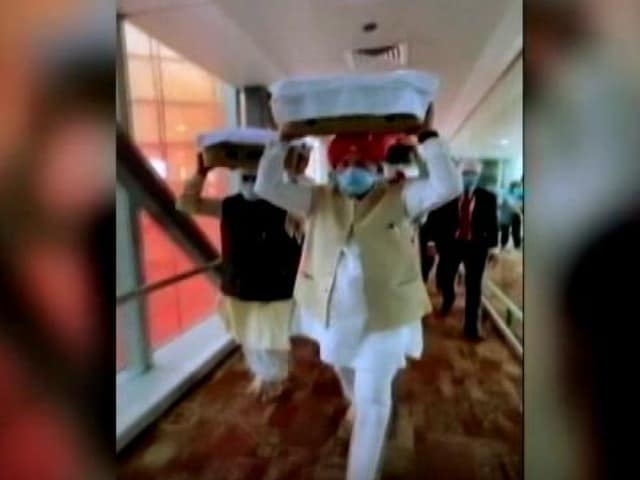Video : Minister Carries Holy Book Flown In From Kabul