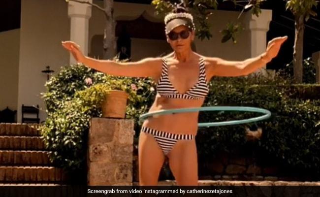 Catherine Zeta-Jones, 51, Is 'In A Twist' Mode. See Her Fun Clip Here