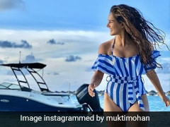 Mukti Mohan Continues Making Waves With Her Striped Swimsuit