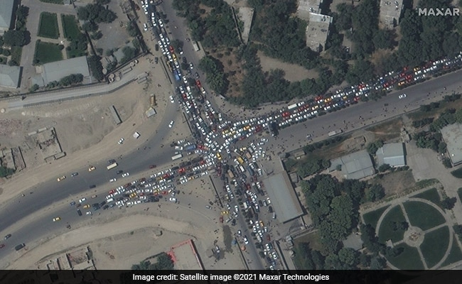 Exclusive: Kabul Satellite Images Show Huge Crowds Desperate To Get Out