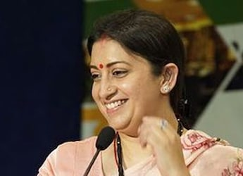Smriti Irani Is Devouring Some Delicious Choorma Laddoos, And It Will Surely Make You Drool