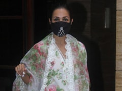Malaika Arora's Breezy Floral Suit Gets An Elegant Rs 3.8 Lakh Lady Dior Touch To It