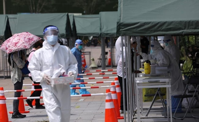 China Reports More COVID-19 Cases, Some Cities Kick Off New Tests