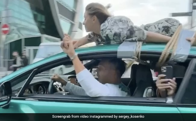 Watch: Man Drives With Girlfriend Tied To Roof In Bizarre 'Trust Test'