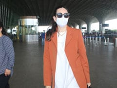 Karisma Kapoor's Rustic Casual Chic Airport Outfit Is Incomplete Without Her Rs 5 Lakh Chanel Handbag